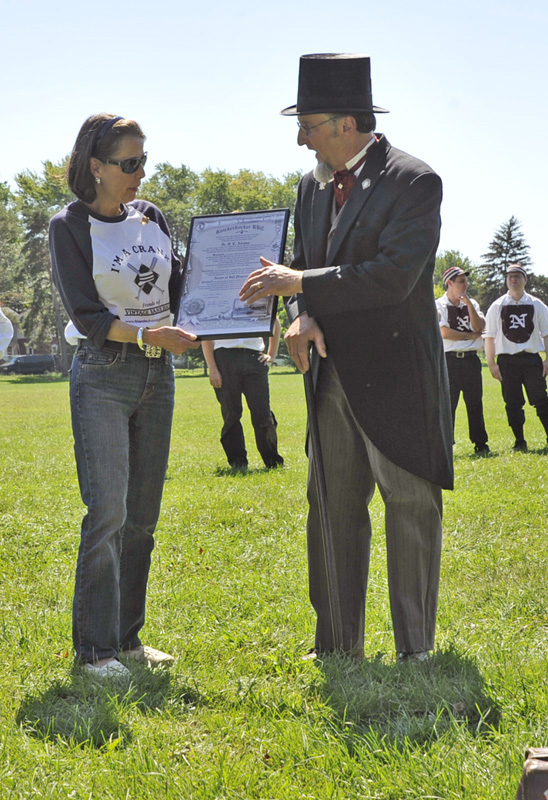 "Gary ""Pops"" O'Maxfield presents Marjorie Adams a symbolic ""Nestor of Ball Players"" document at The Hartford Base Ball Grounds at Colt Meadows on Doc Adams Day, September 10, 2011."
